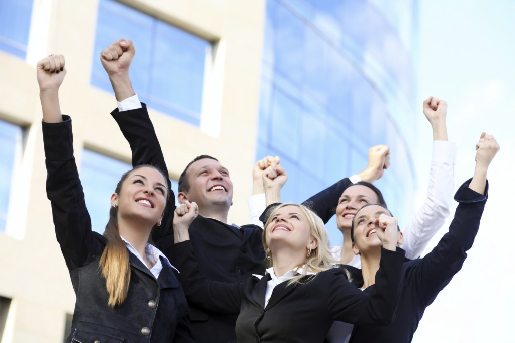 Successful businesspeople with hands up 7814530